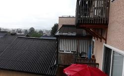 Deštivý Golling z okna hotelu